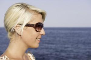 Female wearing cK sunglasses